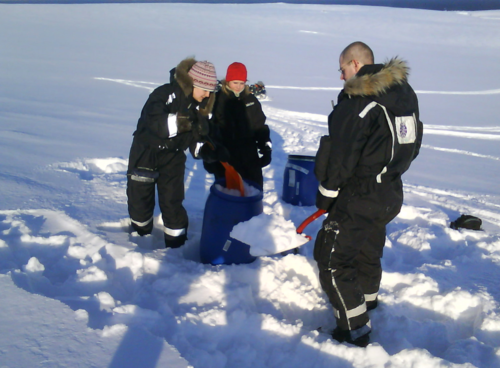 Students sampling snow in Svalbard.