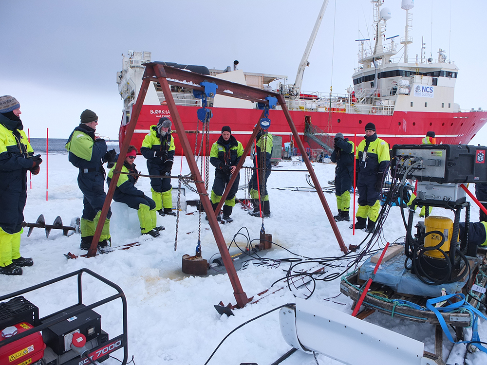 Scientists on the sea ice in front of MS Bjørkhaug. Photo: Andrii Murdza
