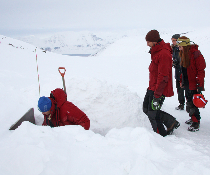 The Royal couple enter the ice cave accompanied by UNIS master student Silje Smith Johnsen.