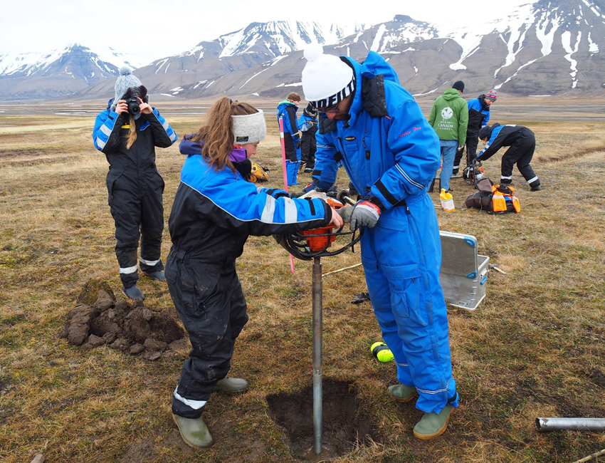 Students drilling in permafrost in Adventdalen