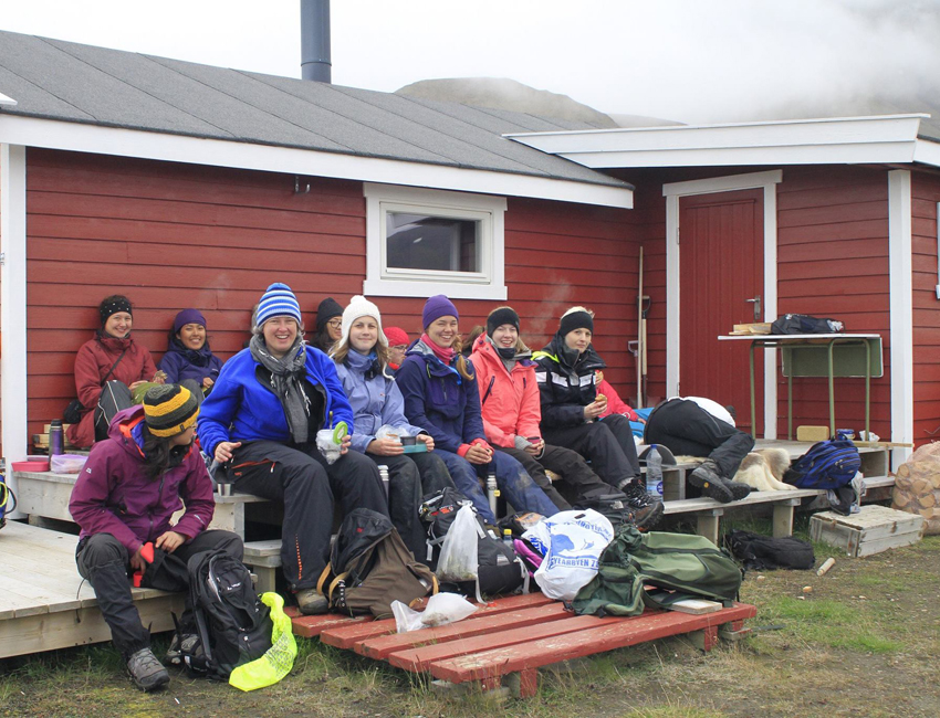 Student lunch break outside a cabin at Hiorthhamn