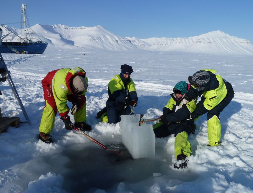 Sampling sea ice in Dicksonfjorden Svalbard