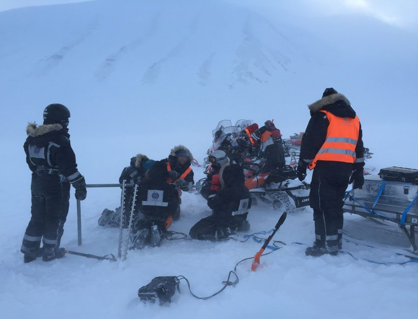 Students performing fieldwork on Tellbreen Svalbard