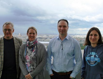 Prof. Pillipenko, Assoc. Prof. Baddeley, Prof. Lorentzen and Ms. Nosikova on the balcony of the Main building at Moscow State University with the city of Moscow in the background.