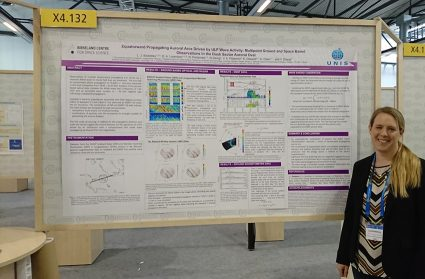 Assoc. Prof. Lisa Baddeley (UNIS) in front of her poster.
