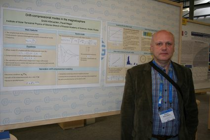 Dr Dmitri Klimushkin (Inst. Of Solar Terrestrial Research, Irkusk, Russia) in front of his poster.