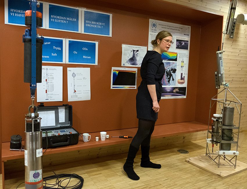 PhD candidate Eli Anne Ersdal demonstrates research instruments used by the Arctic Geophysics department at UNIS. Photo: Eirik Berger