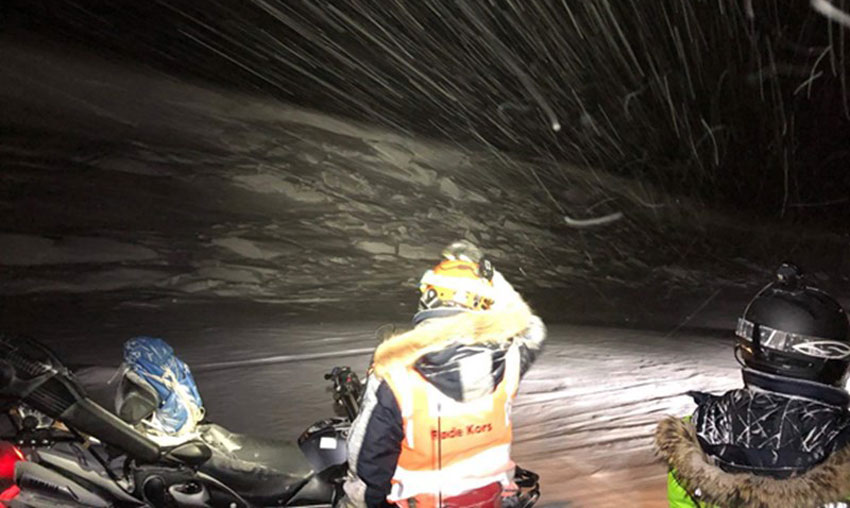 The local Red Cross observes an avalanche area in Svalbard