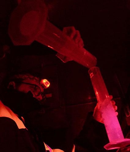 Measuring water in a dark, cool room.