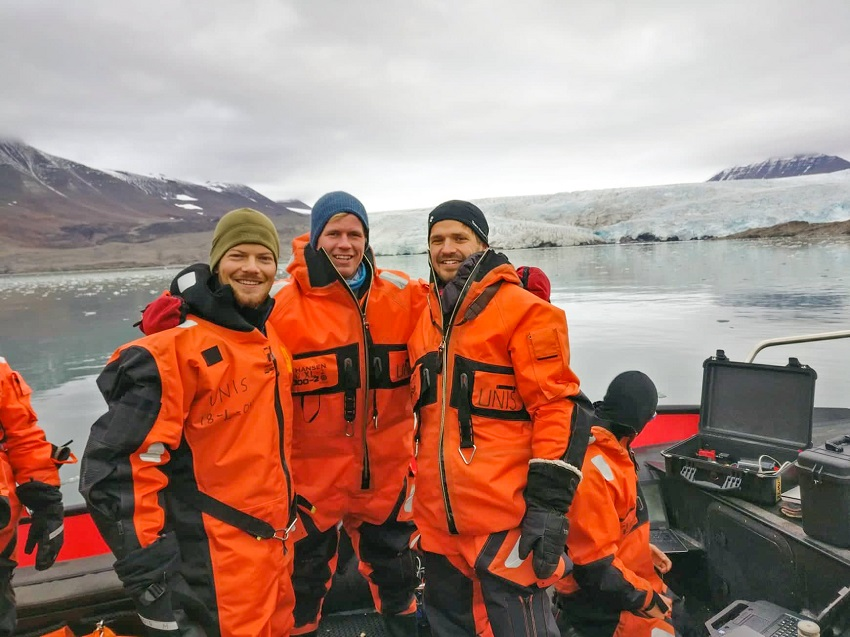 Three students in front of the Nordenskiöld glacier.