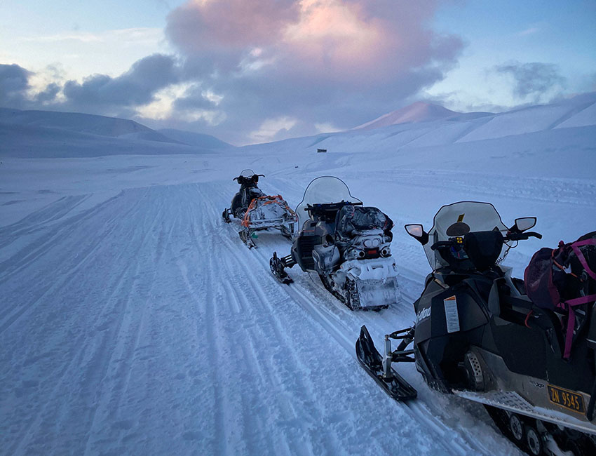 Snowmobile driving on Svalbard