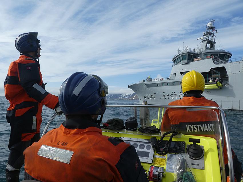 On a small boat heading towards KV Barentshav in Svalbard