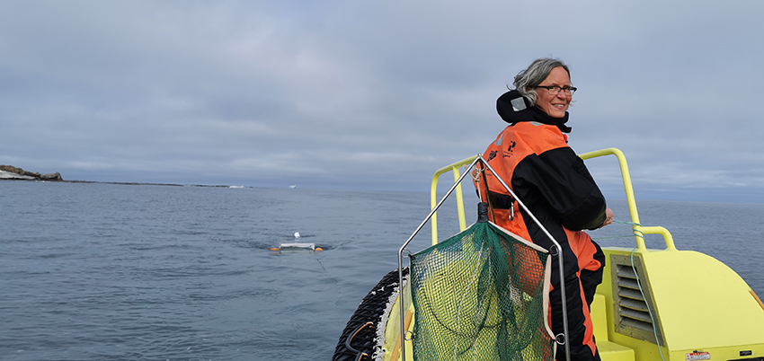 Anna Vader trawling for plankton and microplastics in surface water in Svalbard